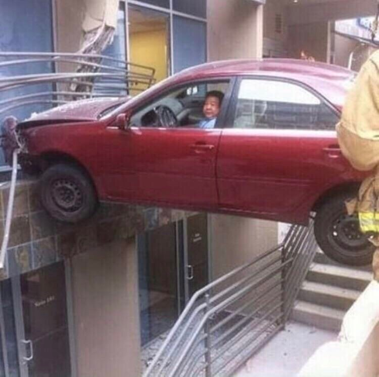 pic of car stuck in mid air above a staircase