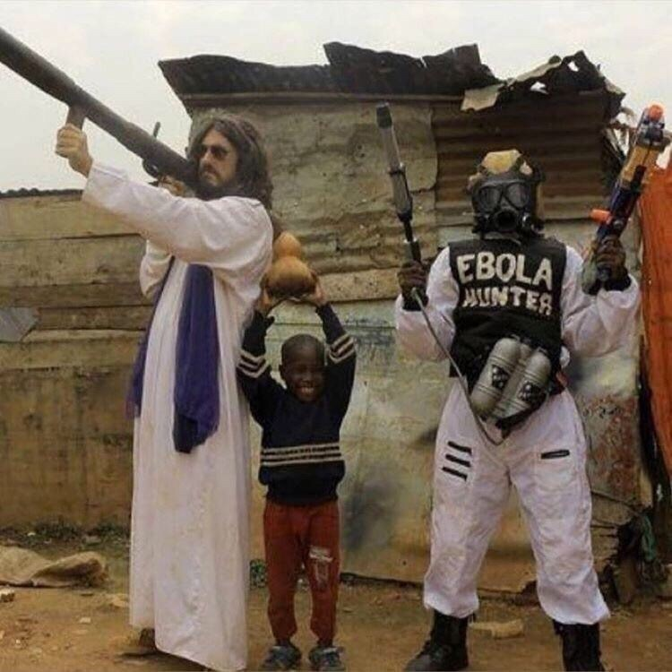 "pic of Jesus shooting a bazooka next to small child holding a vegetable and person in gas mask wearing an ""Ebola hunter"" vest"
