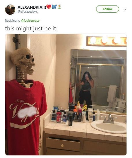 picture of guy's bathroom with human skeleton wearing a t shirt