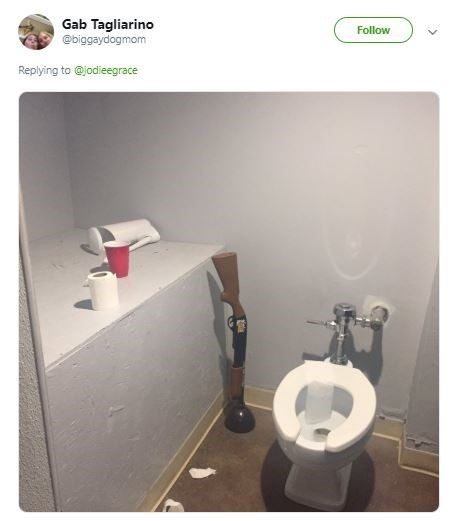 picture of bathroom with toilet that has no cover, plunger shaped like a shotgun, and random plastic cup