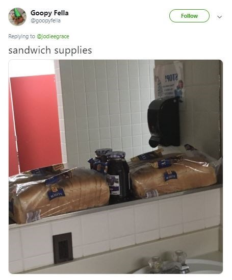 pic of bags of bread and a jar of jam above the sink in the men's bathroom