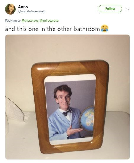 framed picture of Bill Nye the Science guy in the men's bathroom
