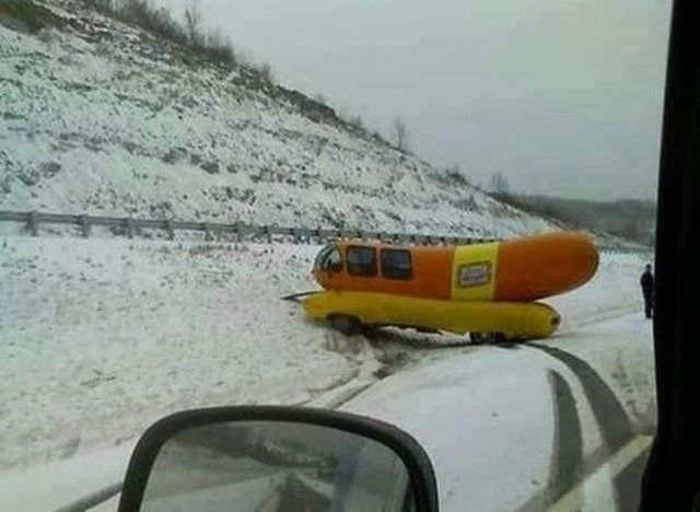 unfortunate moments of a hot dog shaped car that crashed in the snow