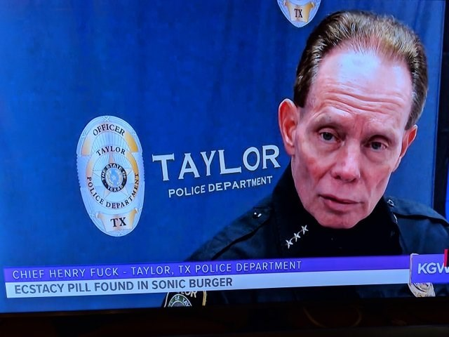 bad timing meme of a tv interview with a cop and a banner on the news site that's taking about ecstasy
