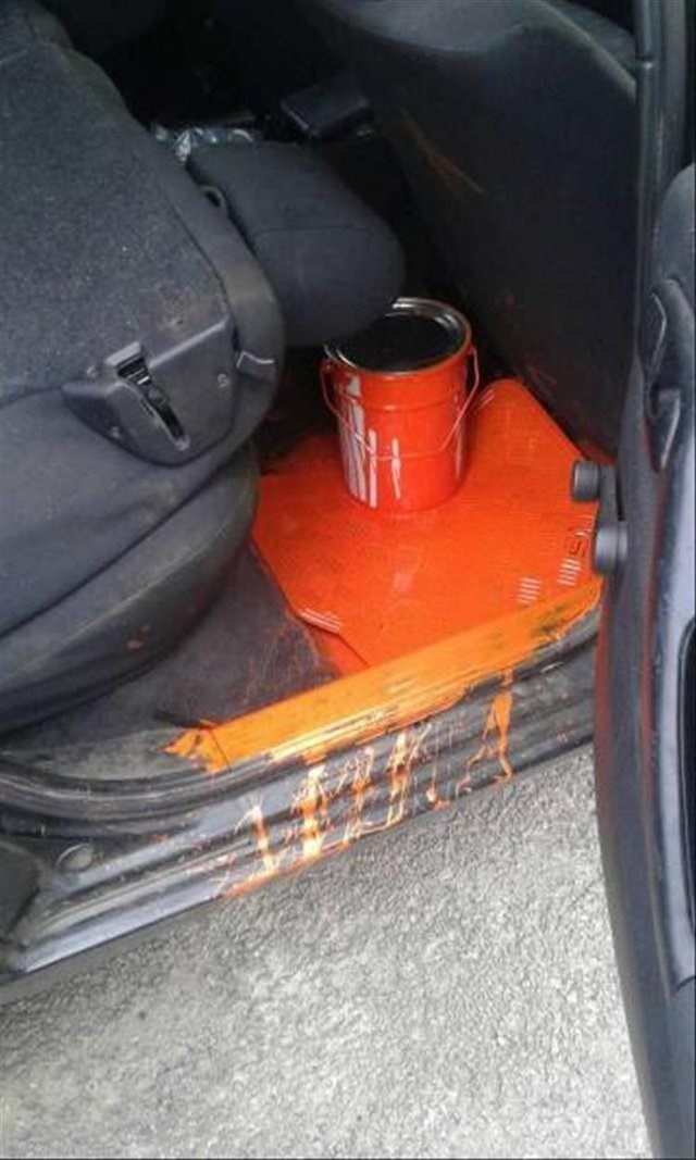 unfortunate moment of a can of paint that spilled all over the backseat of a car