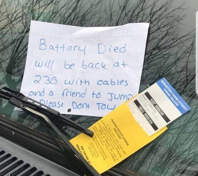 unfortunate moment of a person who got ticketed after his car died and wrote a sign he'd be right back