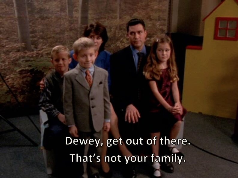 Malcolm In the Middle scene of Dewey taking family pic with wrong family