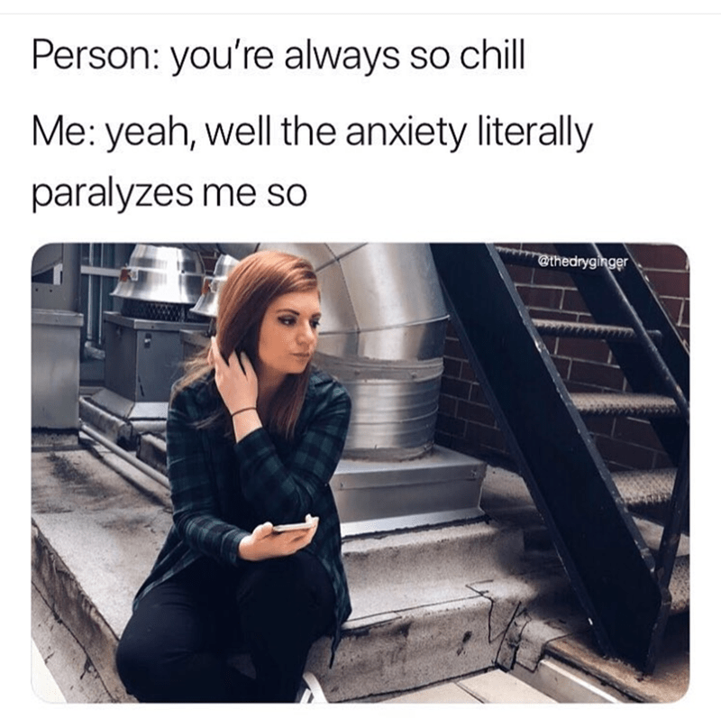 """Caption that reads, """"Person: you're always so chill; Me: yeah, well the anxiety literally paralyzes me so"""" above a stock photo of a girl holding her cell phone while looking off sadly into the distance"""