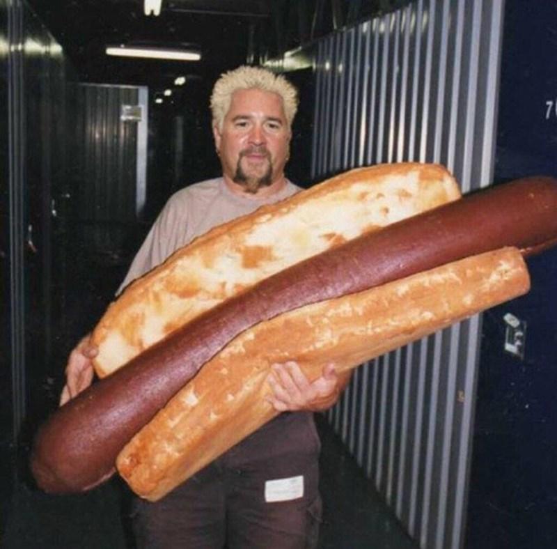 cursed image - Thuringian sausage - 7 Guy Fieri holding massive hot dog