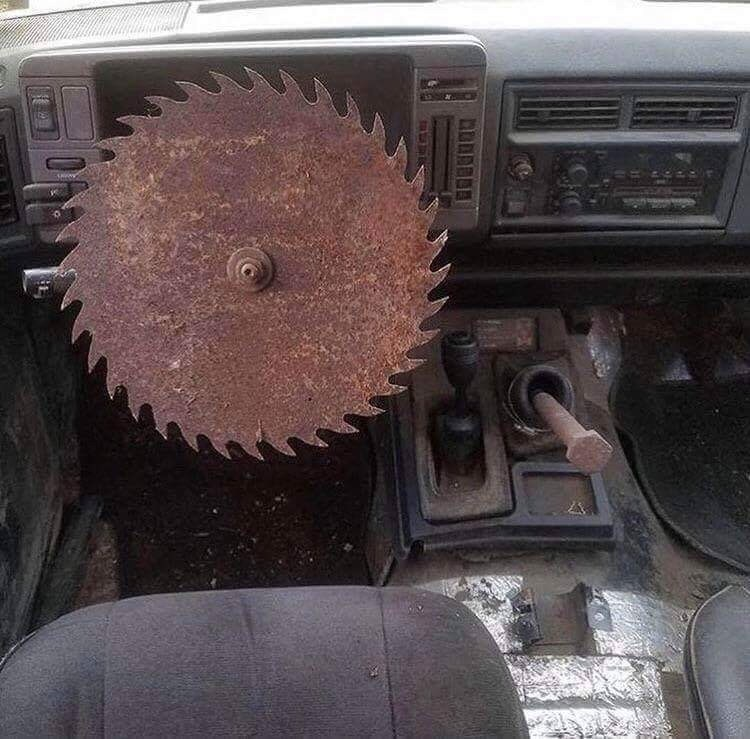 cursed image - Vehicle with saw for steering wheel