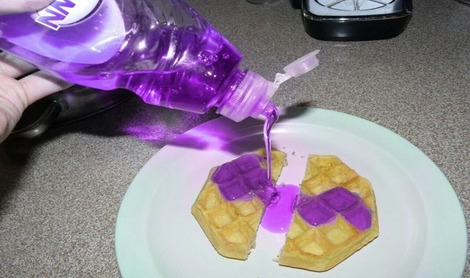 cursed image of purple dish soap poured over a waffle