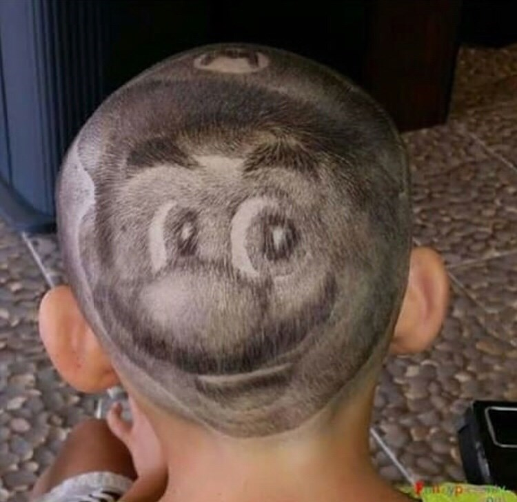 cursed image of Mario's face shaved on back of kid's head