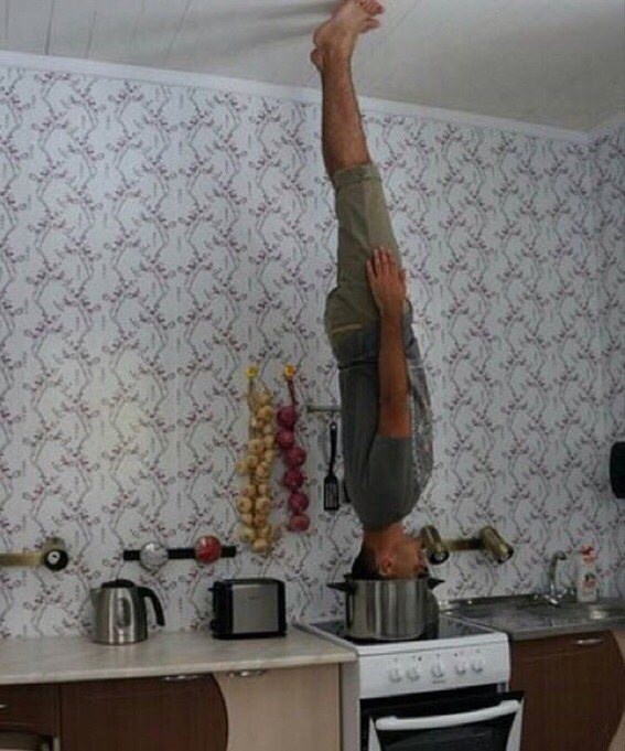 cursed_image - headstand in a pot on the stove