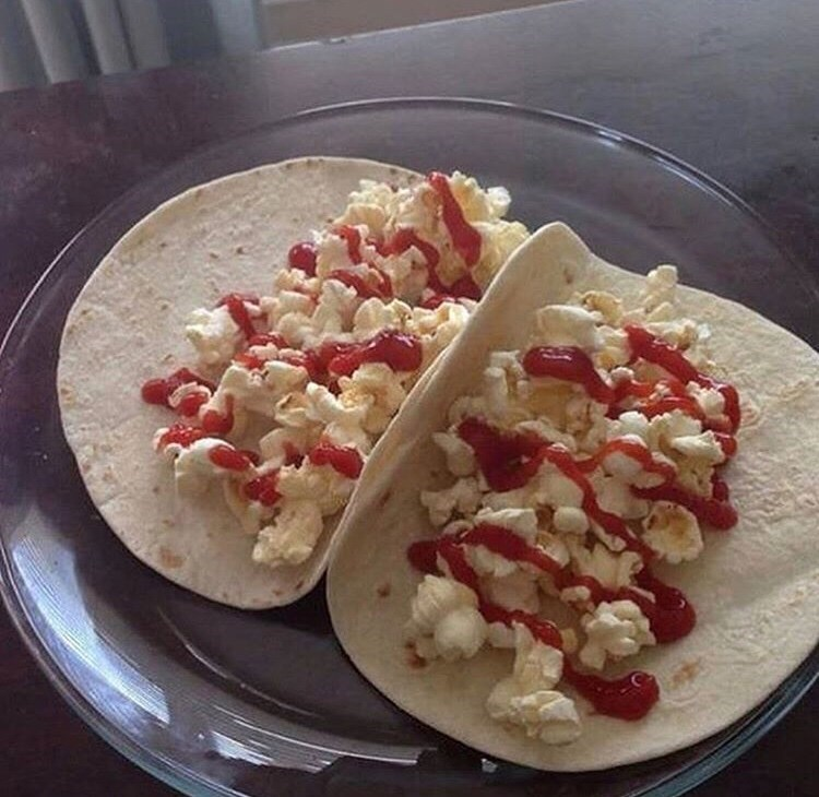 cursed_image - Dish of popcorn tacos with ketchup
