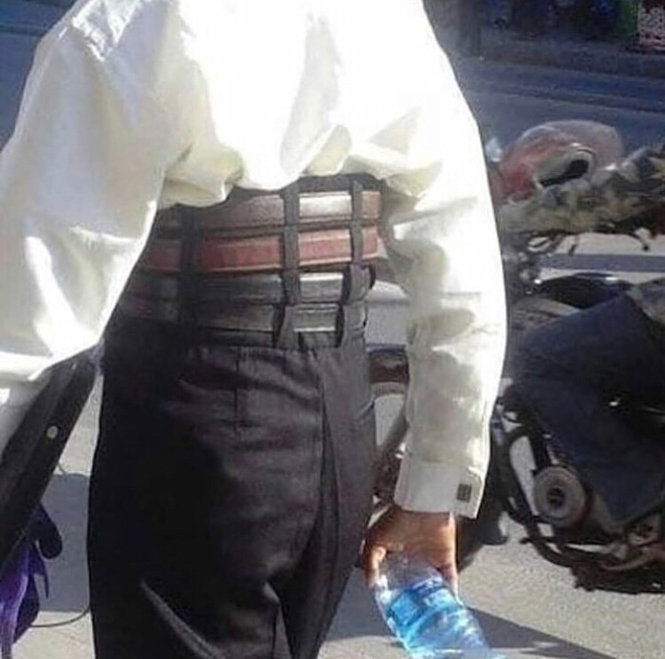 cursed_image of wearing pants with too many belts