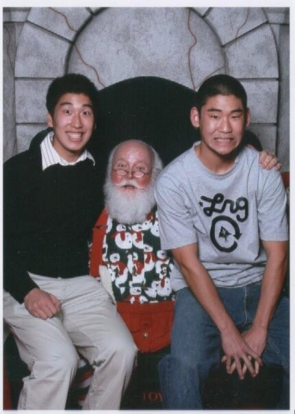 funny santa Pic of two awkward-looking guys sitting on Santa's lap