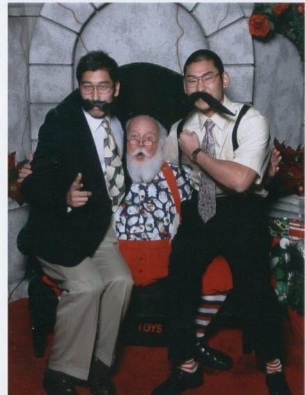 funny santa Pic of the two guys wearing very long mustaches