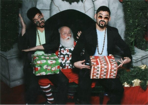 funny Santa pic of two guys sitting on santa's lap dressed as gangsters