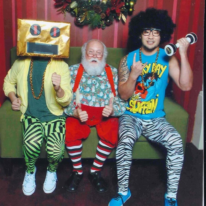 funny Santa pic of guys dressed as LMFAO costumes while sitting on Santa's lap