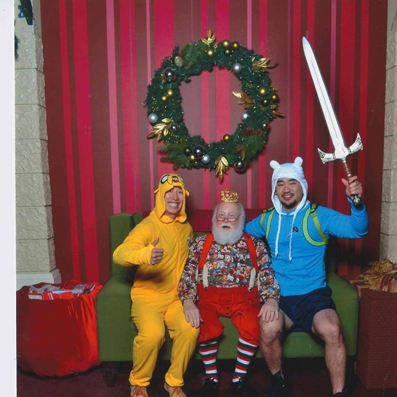 funny Santa pic of guys dressed as Adventure Time costumes while sitting on Santa's lap