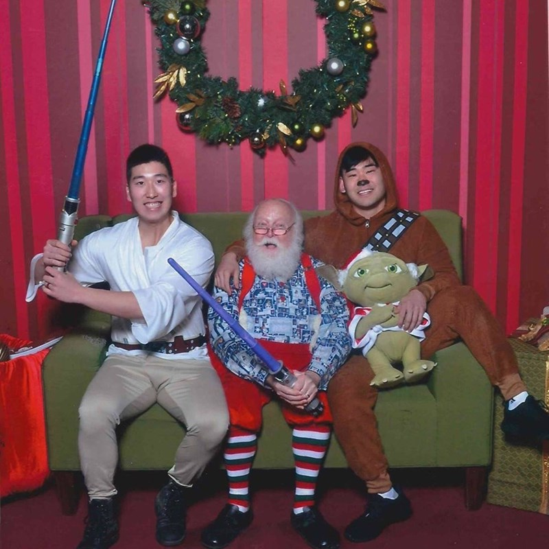 funny Santa pic of guys dressed as Star Wars costumes while sitting on Santa's lap