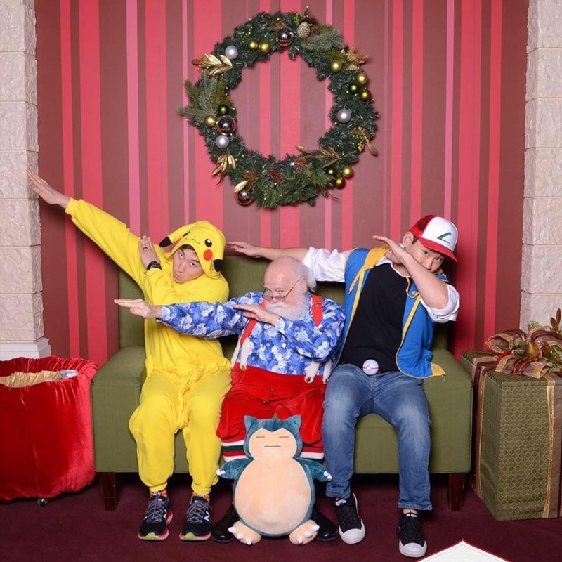 funny Santa pic of guys dressed in Pikachu costumes while sitting on Santa's lap