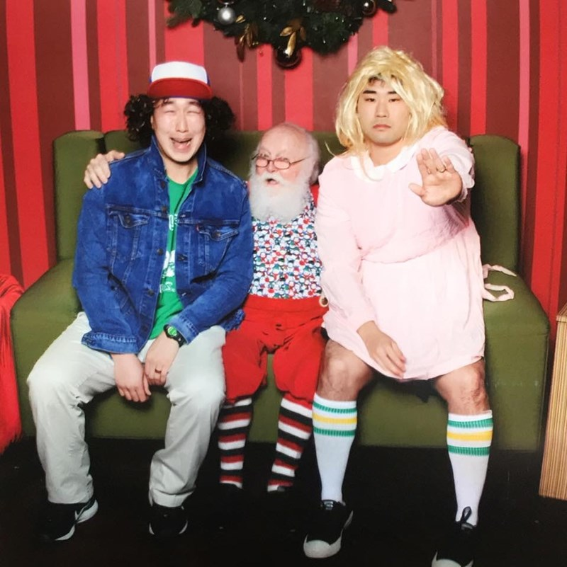 funny Santa pic of guys dressed in costumes while sitting on Santa's lap