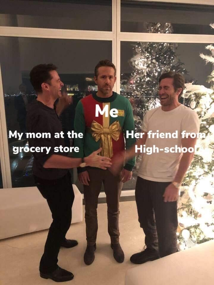 """Pic of Hugh Jackman, who represents """"My mom at the grocery store"""" laughing and joking with Jake Gyllenhaal, who represents """"Her friend from high school;"""" Ryan Reynolds, who represents """"me"""" is awkwardly standing in the back"""