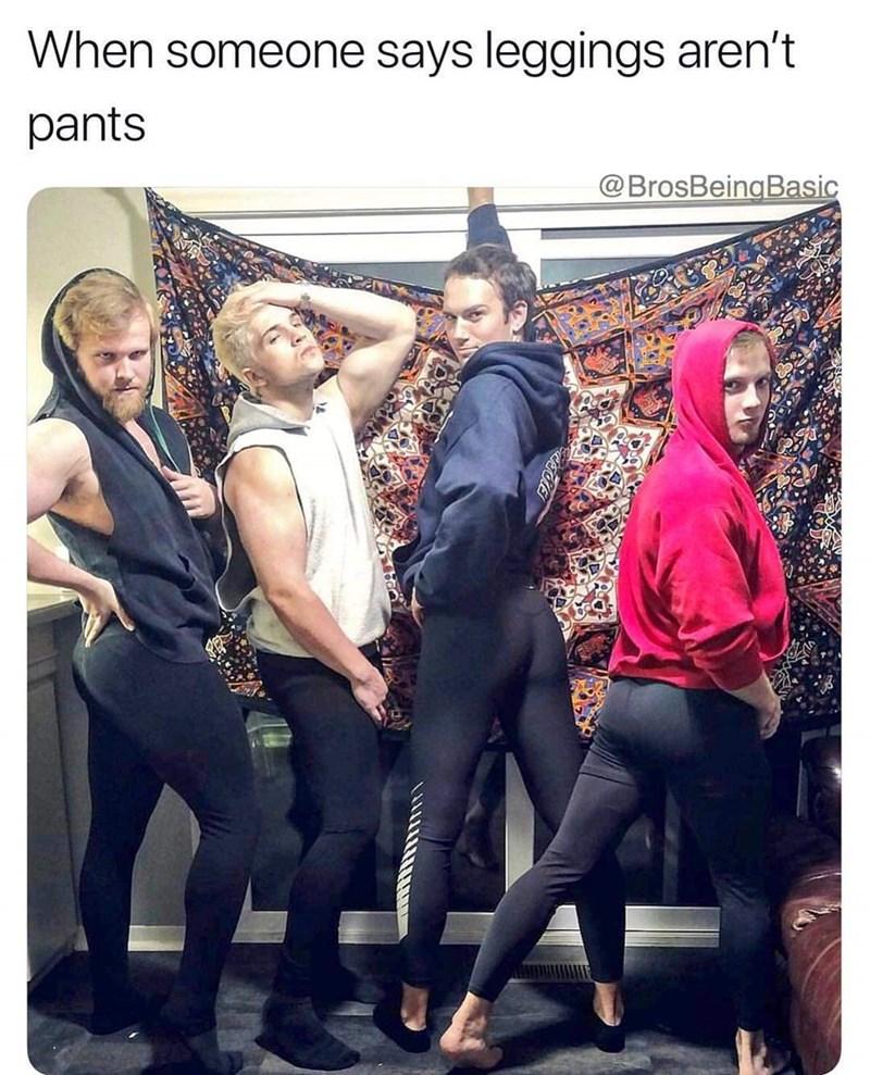 basic bros posing in a group while wearing black leggings