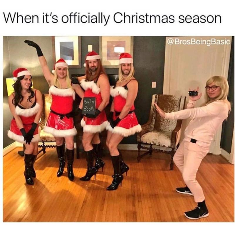 basic bros dressed in women's Santa costumes