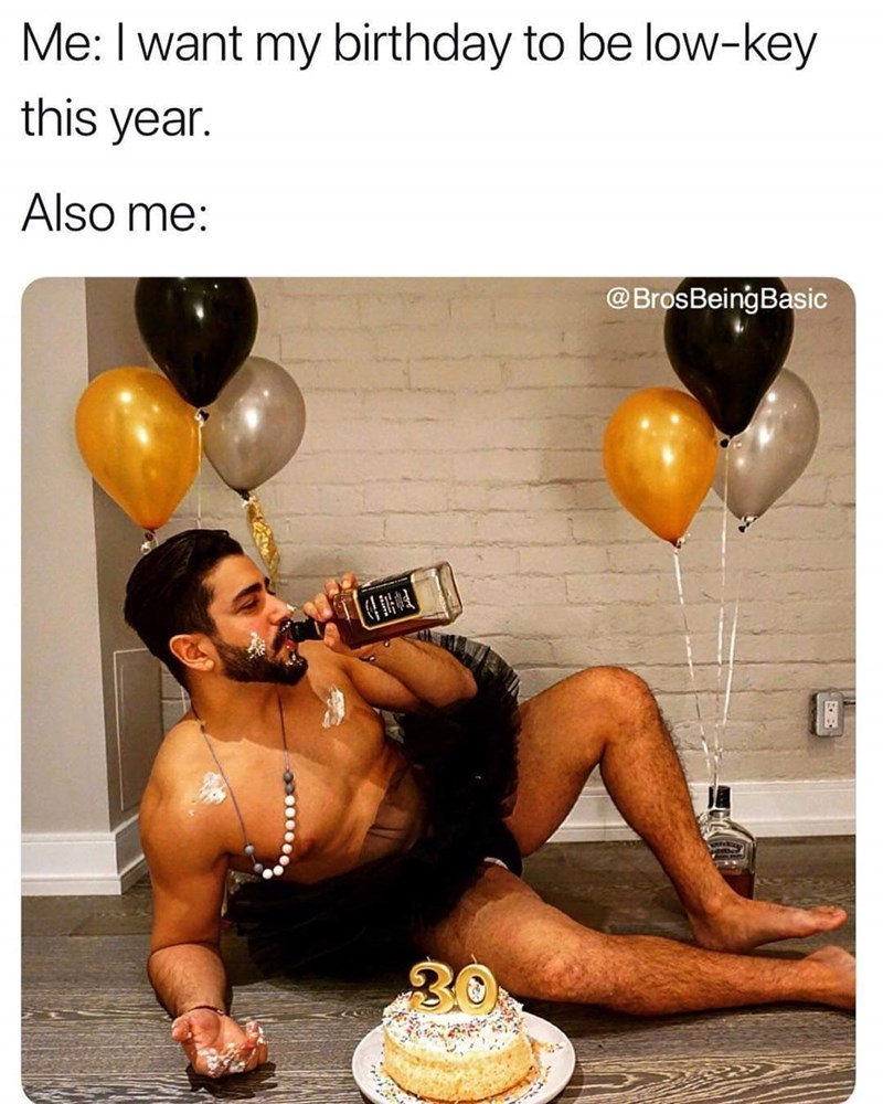 basic bros birthday with a bottle of whiskey and posing on the floor