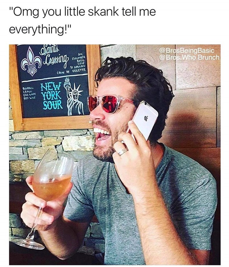 basic bros laughing while on the phone and drinking a glass of wine