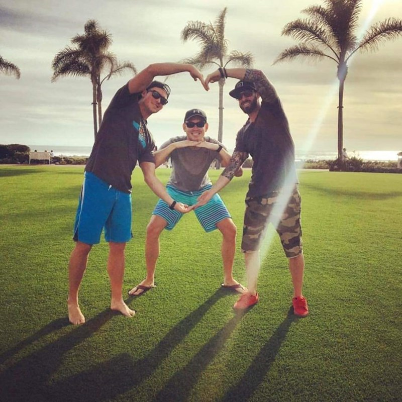 basic bros posing by making their arms into shapes of hearts