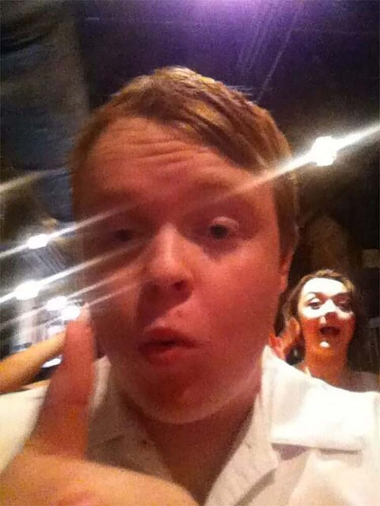 boy taking a selfie celebrity photo-bombed by maisie williams
