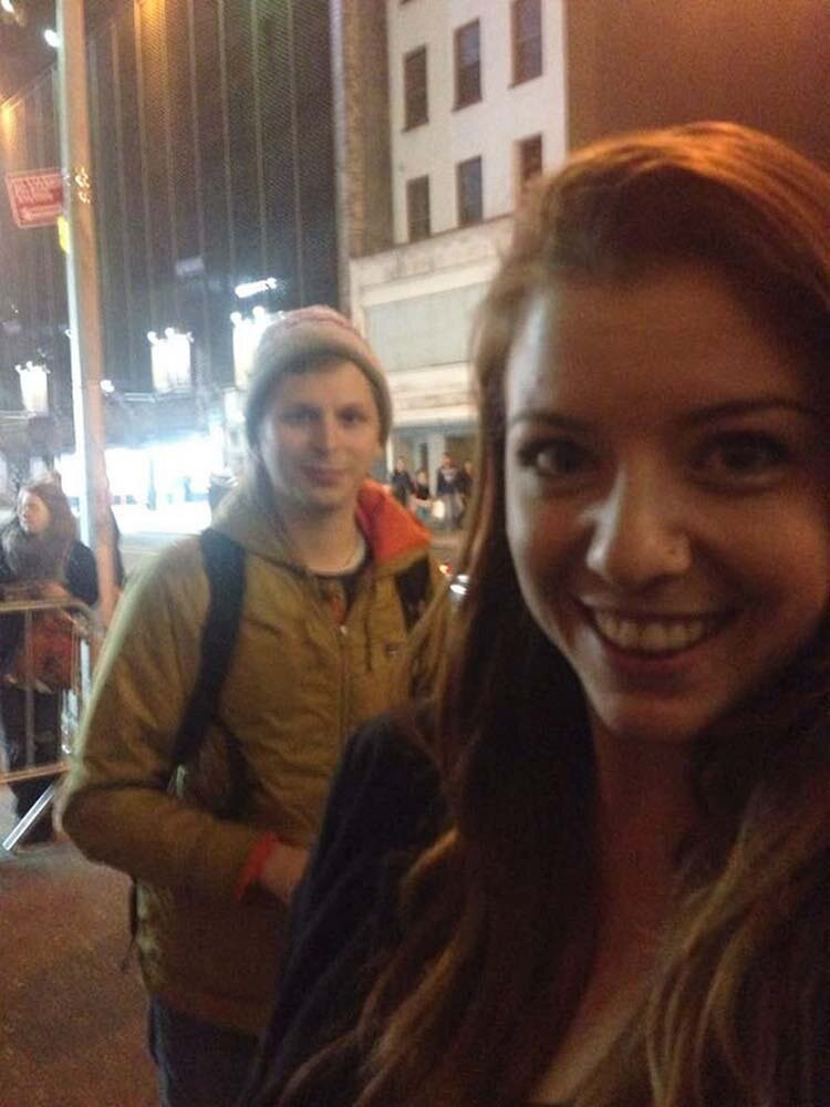 girl taking a selfie photo-bombed by Michael Cera