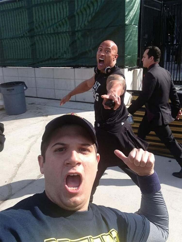 guy photo-bombed by Dwayne the Rock Johson