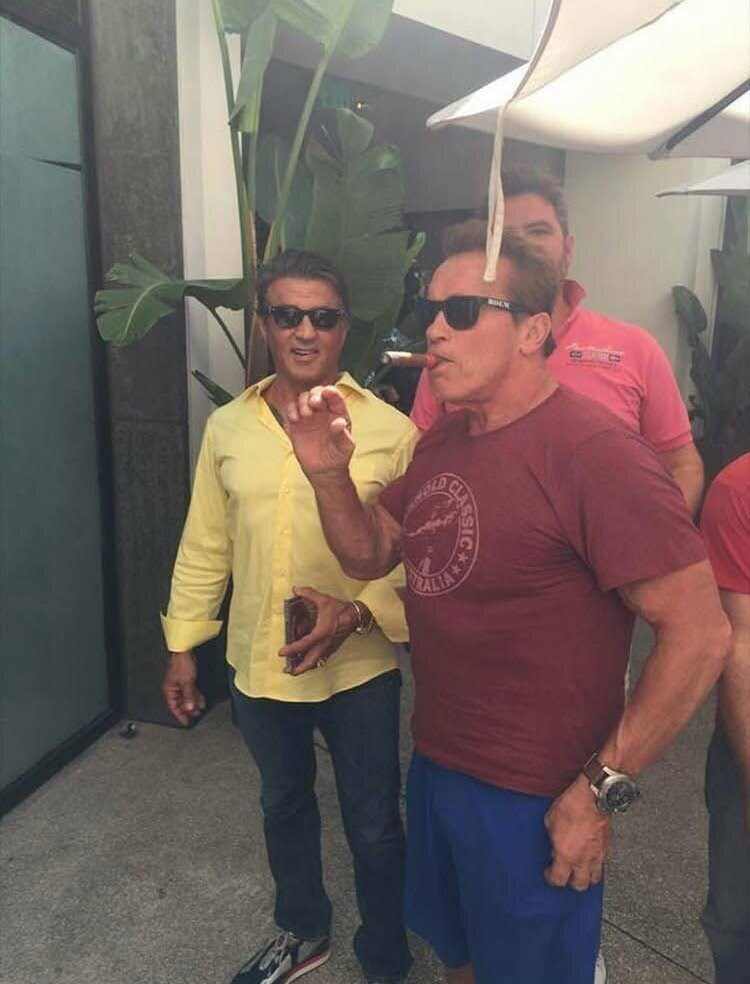 celebrity photobomb by Sylvester stallone and Arnold Schwarzenegger