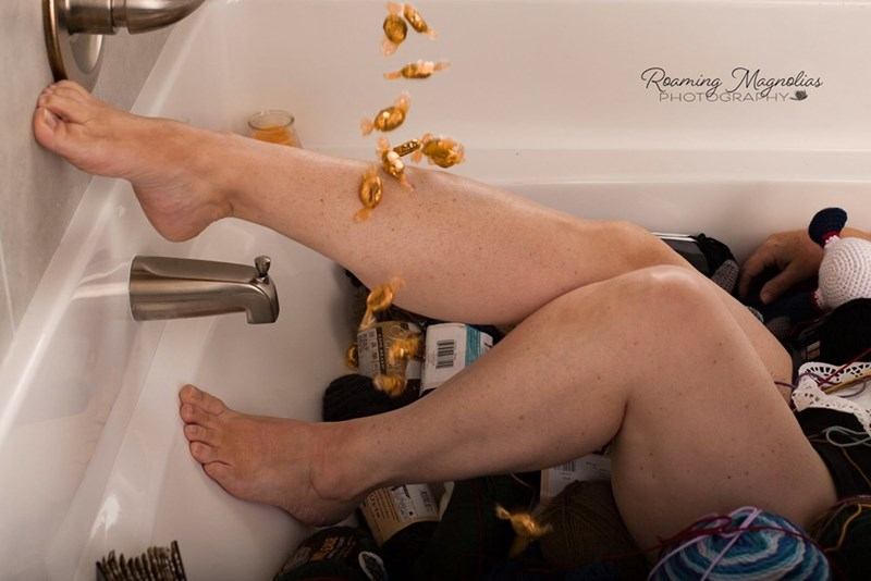 wholesome pic of a woman's leg posing against the wall while in a tub