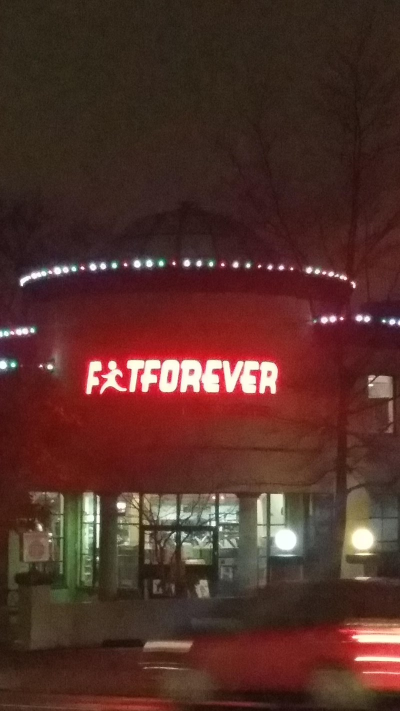 "crappy design of gym sign that looks like it spells ""fat forever"""