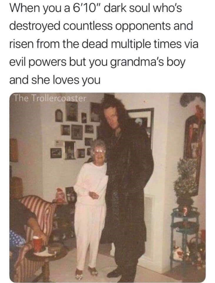 wholesome pic of the Undertaker posing with his small mother