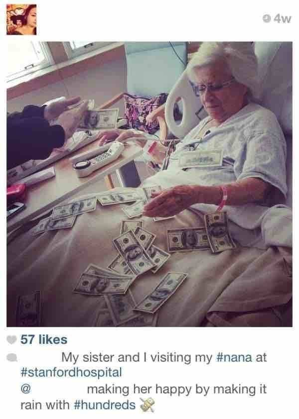 pic of old woman in a hospital bed showered with money to make her feel better