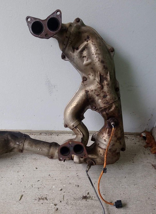 creepy pic of metal tubes looking like a shape of a standing cat