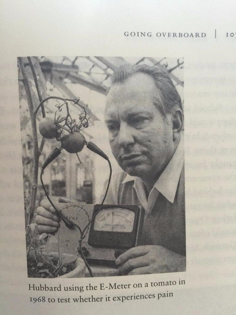 """Caption that reads, """"Hubbard using the E-Meter on a tomato in 1968 to test whether it experiences pain"""" below a pic of L. Ron Hubbard"""