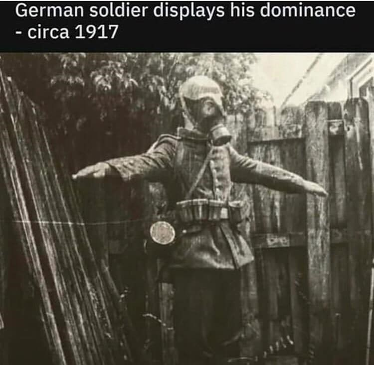 black and white photo of a soldier in a gas mask t posing
