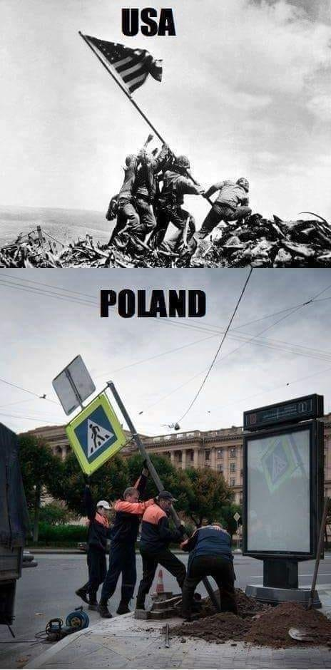 """men in Poland putting up a crosswalk sign and mirroring the iconic """"raising the flag on Iwo Jima"""" pic"""