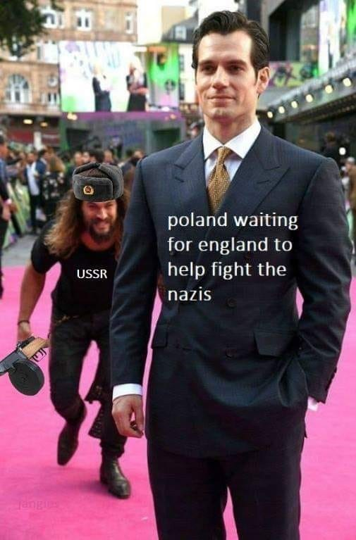 WWII meme about USSR surprising Poland represented by Jason Momoa sneaking on unsuspecting Henry Cavill