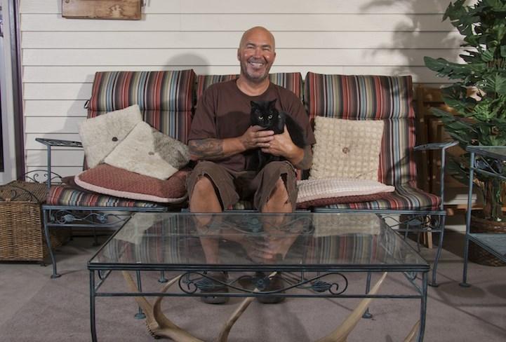 man loves cats - Sitting