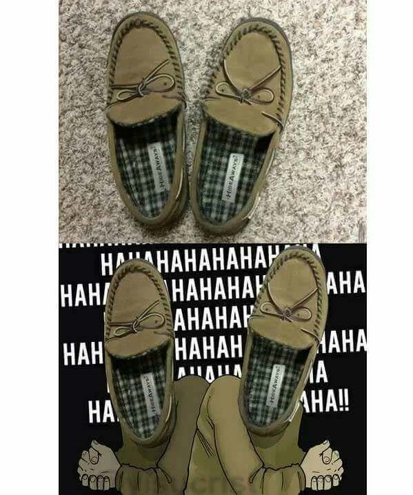 Pic of house slippers that look like two evil men laughing manically