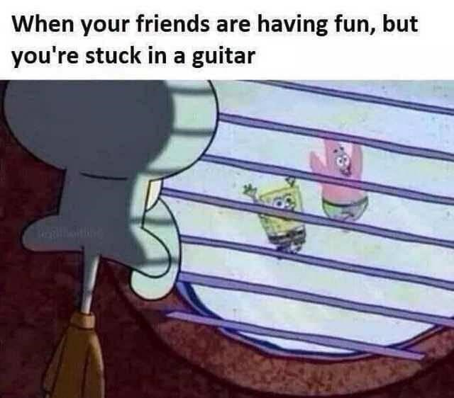 "Caption that reads, ""When your friends are having fun, but you're stuck in a guitar"" above a pic of Squidward staring out of some blinds at Spongebob and Patrick having fun without him"