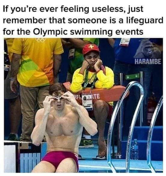"Caption that reads, ""If you're ever feeling useless, just remember that someone is a lifeguard for the Olympic swimming events"" above a pic of a bored lifeguard at the Olympics"